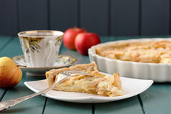 Apple tart with cup of tea and three whole apples Royalty Free Stock Photography