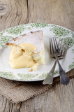 Apple tart with custard on a plate Stock Photos