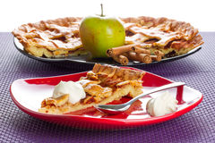 Apple tart dessert with cream. On the plate Royalty Free Stock Photos