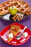 Apple tart dessert on the plate. Apple tart dessert with cream on the plate Stock Photography
