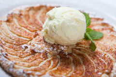 Apple tart, flat apple pie with ice cream on the white background.  Stock Photo