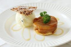 Apple tart with ice cream. Warm apple tart with vanilla ice cream Royalty Free Stock Photos