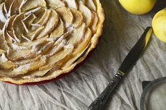 Apple Tart. Open apple pie, laid out in the shape of a rose Royalty Free Stock Photography