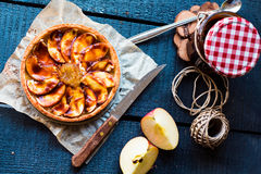 Apple tart with pear jam and caramel, top view Royalty Free Stock Image