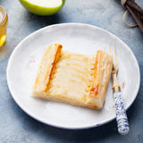Apple tart, puff pastry strips with vanilla custard. On a stone background Royalty Free Stock Photography