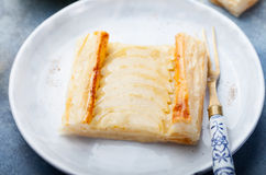 Apple tart, puff pastry strips with vanilla custard. On a stone background Royalty Free Stock Photo