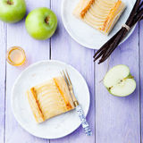 Apple tart, puff pastry strips with vanilla custard on a wooden background. Apple tart, puff pastry strips with vanilla custard on a stone background Royalty Free Stock Photo