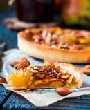 Apple tart on a sand base with caramel on parchment Royalty Free Stock Photos