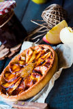Apple tart on a sand base with pear jam and caramel Stock Photo