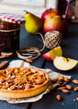 Apple tart on a sand base with pear jam and caramel Royalty Free Stock Images