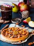 Apple tart on a sand base with pear jam and caramel Stock Photos