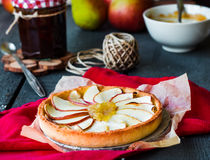Apple tart on a sand base with pear jam and caramel Stock Photography