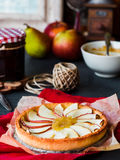 Apple tart on a sand base with pear jam and caramel Royalty Free Stock Photography