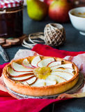 Apple tart on a sand base with pear jam and caramel Stock Images