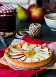 Apple tart on a sand base with pear jam and caramel Royalty Free Stock Image