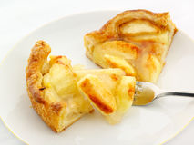 Apple tart serving. Apple tart, dusted with cinnamon, with forkful ready to eat Royalty Free Stock Image