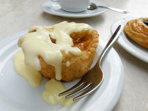 Apple tart with vanilla sauce. Equipped with a fork on a cafe table Stock Photos