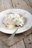 Apple tart with whipped cream on a plate Royalty Free Stock Image