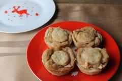 Apple tarts on red plate Stock Photo