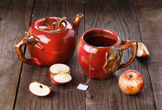 Apple tea and apples over rustic wooden background Stock Photos