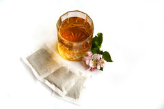 Apple tea. Cold apple tea, apple flowers and packets Stock Image