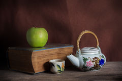 Apple and tea kit with book. Royalty Free Stock Photo
