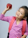 Apple for the teacher 3. A young girl shows off the apple for her teacher Stock Image