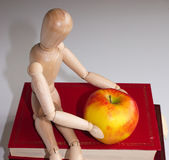 Apple for the teacher. Mannequin leaving a apple for the teacher Stock Image