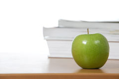 An apple on the teachers desk Stock Photos