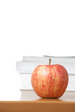 An apple on a teachers desk Royalty Free Stock Photography