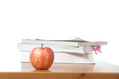 An apple on a teachers desk stock images