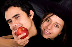 Apple of temptation - couple Royalty Free Stock Image