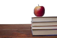 Apple on the textbook Royalty Free Stock Photography