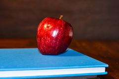 Apple on textbook for teacher