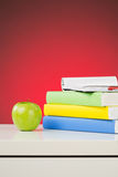 An Apple and Textbooks Stock Photography