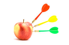 Apple with three darts Royalty Free Stock Image