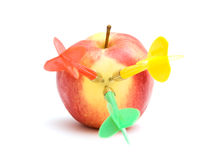 Apple with three darts Stock Photos