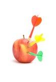 Apple with three darts Royalty Free Stock Photo