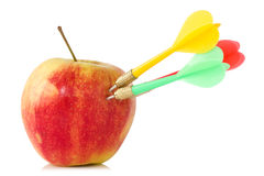 Apple with three darts Stock Images