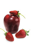 Apple with three ripe strawberry Stock Photography
