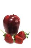 Apple with three strawberry Stock Image