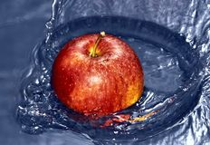 Apple thrown into the water Stock Photography