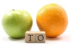 Apple to Orange Stock Photo