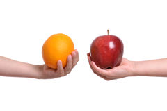 Apple to Orange. Children holding apple to orange white background royalty free stock photos