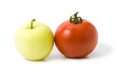 Apple and tomato isolated Royalty Free Stock Photos