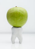 Apple on the tooth Royalty Free Stock Photography