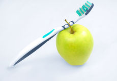 Apple with tooth  brush Stock Photo