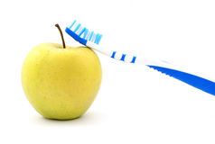 Apple and toothbrush Stock Images