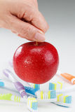 Apple with a toothbrush, on white. dental care concepts Stock Photo