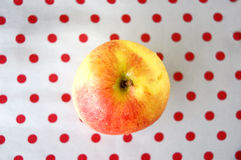Apple on top. View on top of apple with red polka dots background Royalty Free Stock Images